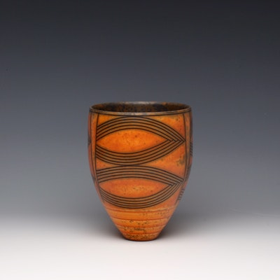 Terra-sigillata vessel form with mottled interior. Height: 16 cm.  Price in GBP: £380.00